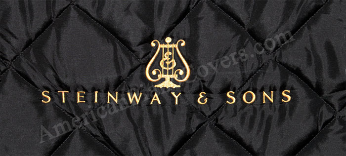 steinway piano cover with gold logo