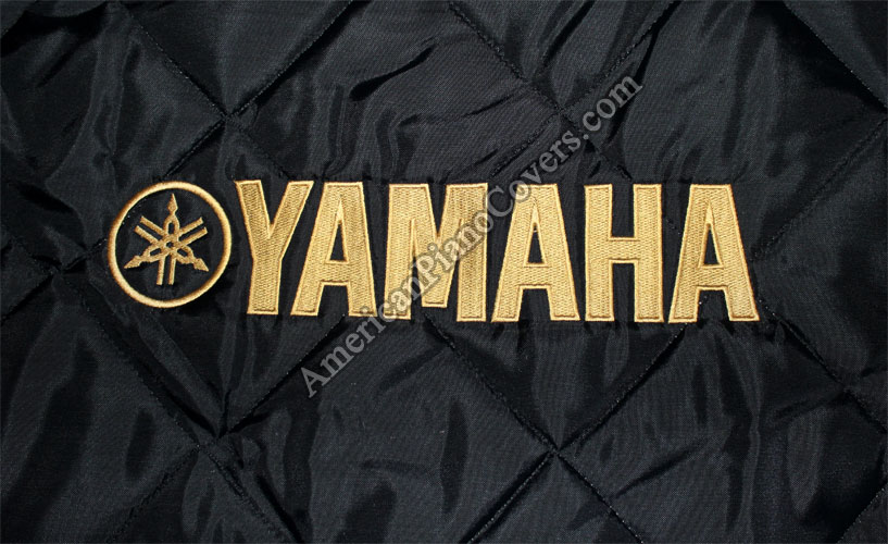 black yamaha piano cover with logo